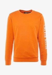 Calvin Klein Performance - Sweatshirt - orange - 5