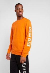 Calvin Klein Performance - Sweatshirt - orange - 0