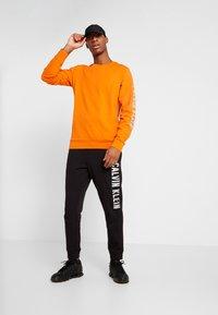 Calvin Klein Performance - Sweatshirt - orange - 1