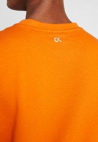 Calvin Klein Performance - Sweatshirt - orange - 6