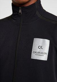 Calvin Klein Performance - LONG SLEEVE JUMPSUIT - Tracksuit - black - 9