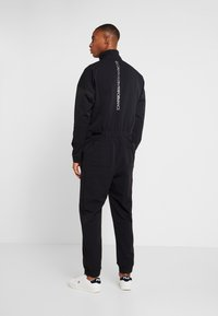 Calvin Klein Performance - LONG SLEEVE JUMPSUIT - Tracksuit - black - 2