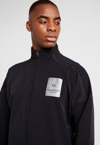 Calvin Klein Performance - LONG SLEEVE JUMPSUIT - Tracksuit - black - 3