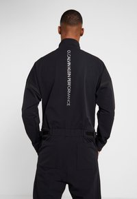 Calvin Klein Performance - LONG SLEEVE JUMPSUIT - Tracksuit - black - 4