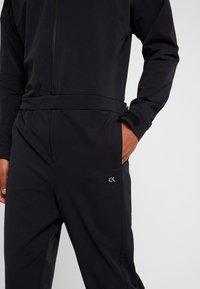 Calvin Klein Performance - LONG SLEEVE JUMPSUIT - Tracksuit - black - 5