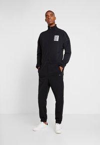 Calvin Klein Performance - LONG SLEEVE JUMPSUIT - Tracksuit - black - 0