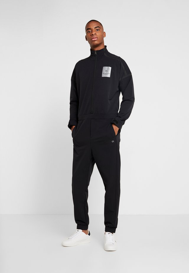 LONG SLEEVE JUMPSUIT - Träningsset - black