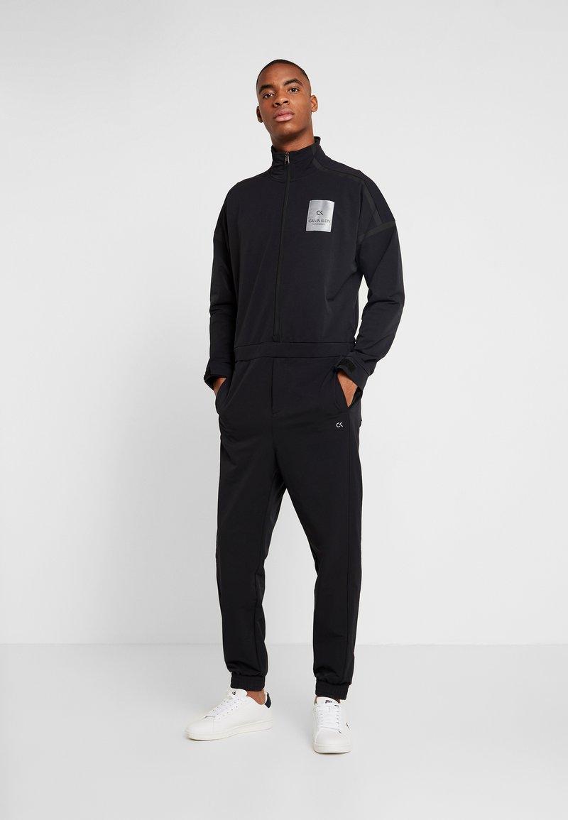 Calvin Klein Performance - LONG SLEEVE JUMPSUIT - Tracksuit - black