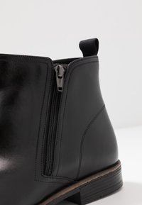 Clarks - STANFORD ZIP - Classic ankle boots - black - 5