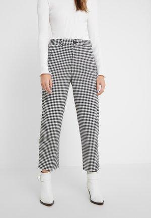 LUDWIG - Trousers - black