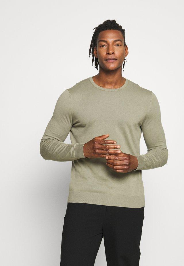 Stickad tröja - soft khaki
