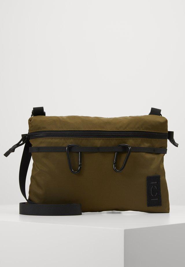 Taška spříčným popruhem - soft khaki