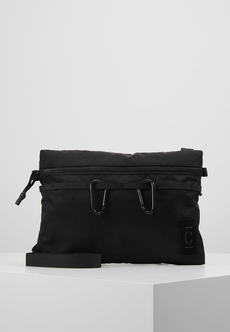 CLOSED - Taška spříčným popruhem - black