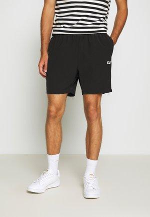 TRACK PANTS - Teplákové kalhoty - black