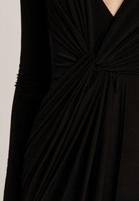 Club L London - SLINKY KNOT ASSYMETRIC DRESS - Maxi dress - black - 5