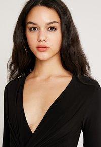 Club L London - SLINKY KNOT ASSYMETRIC DRESS - Maxi dress - black - 3