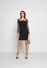 Club L London - LONG SLEEVE PANEL MINI DRESS - Pouzdrové šaty - black - 1