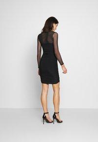 Club L London - LONG SLEEVE PANEL MINI DRESS - Pouzdrové šaty - black - 2