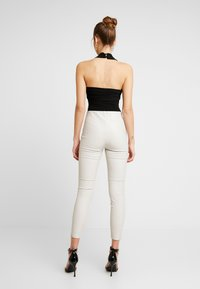 Club L London - CROSS WRAP HALTERNECK BODYSUIT - Top - black - 2