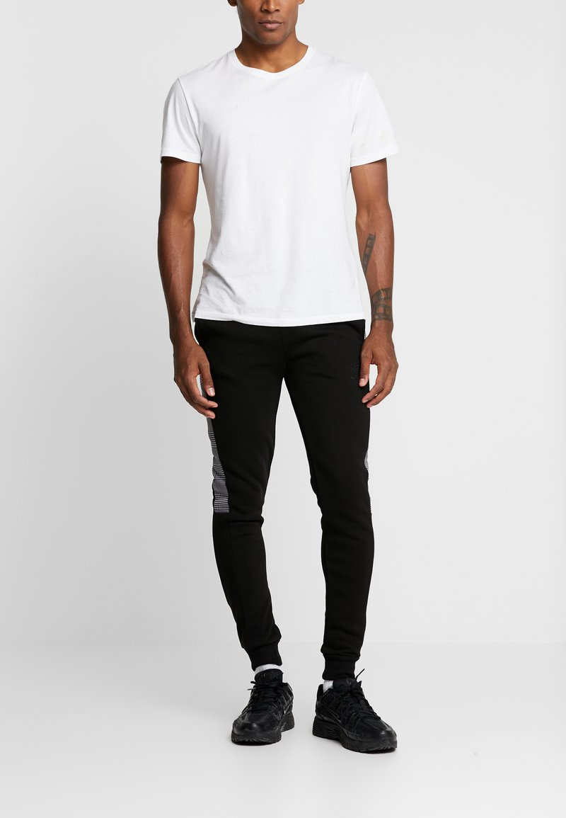CLOSURE London - CONTRAST CHECKE - Tracksuit bottoms - black