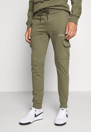 UTILITY JOGGER - Spodnie treningowe - khaki