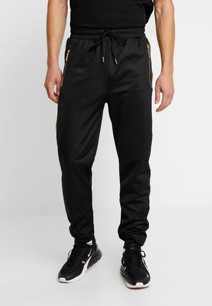 VERINO TRACK JOGGER - Tracksuit bottoms - black/gold