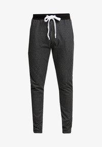 Criminal Damage - PINSTRIPE JOGGER - Spodnie treningowe - black/white - 3