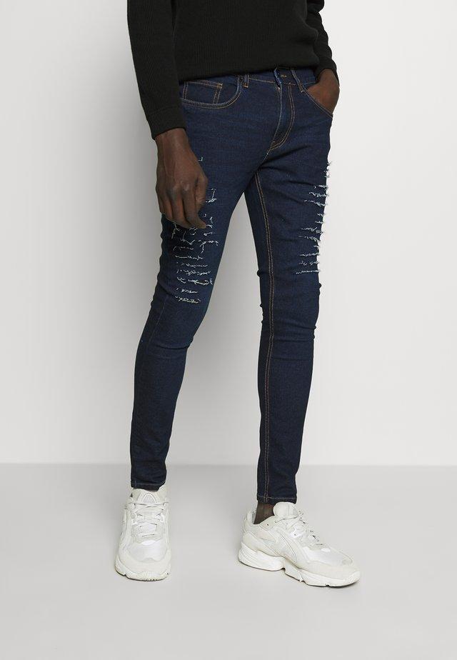 CAMDEN - Skinny džíny - indigo