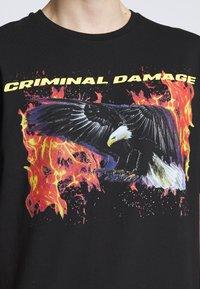 Criminal Damage - EAGLE TEE - Print T-shirt - black/multi - 5