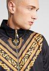 Criminal Damage - TRACK - Training jacket - black/gold