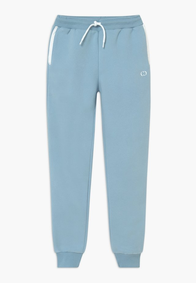 ORDINATE - Tracksuit bottoms - blue/reflective white