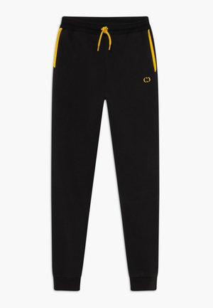 ORDINATE - Tracksuit bottoms - black/reflective yellow