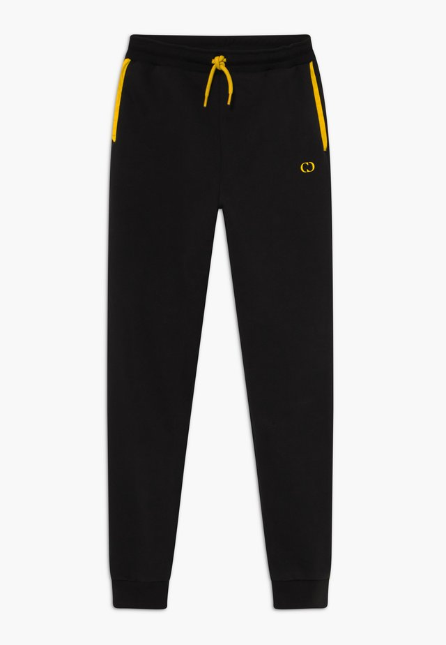 ORDINATE - Jogginghose - black/reflective yellow