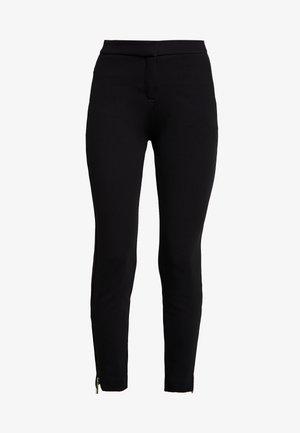 HOSE - Pantalones - black