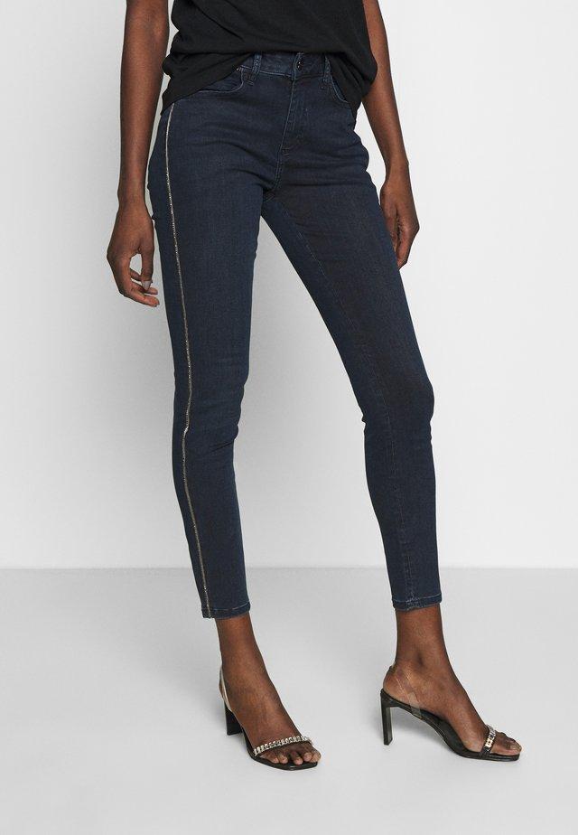 TROUSERS - Slim fit jeans - blue denim