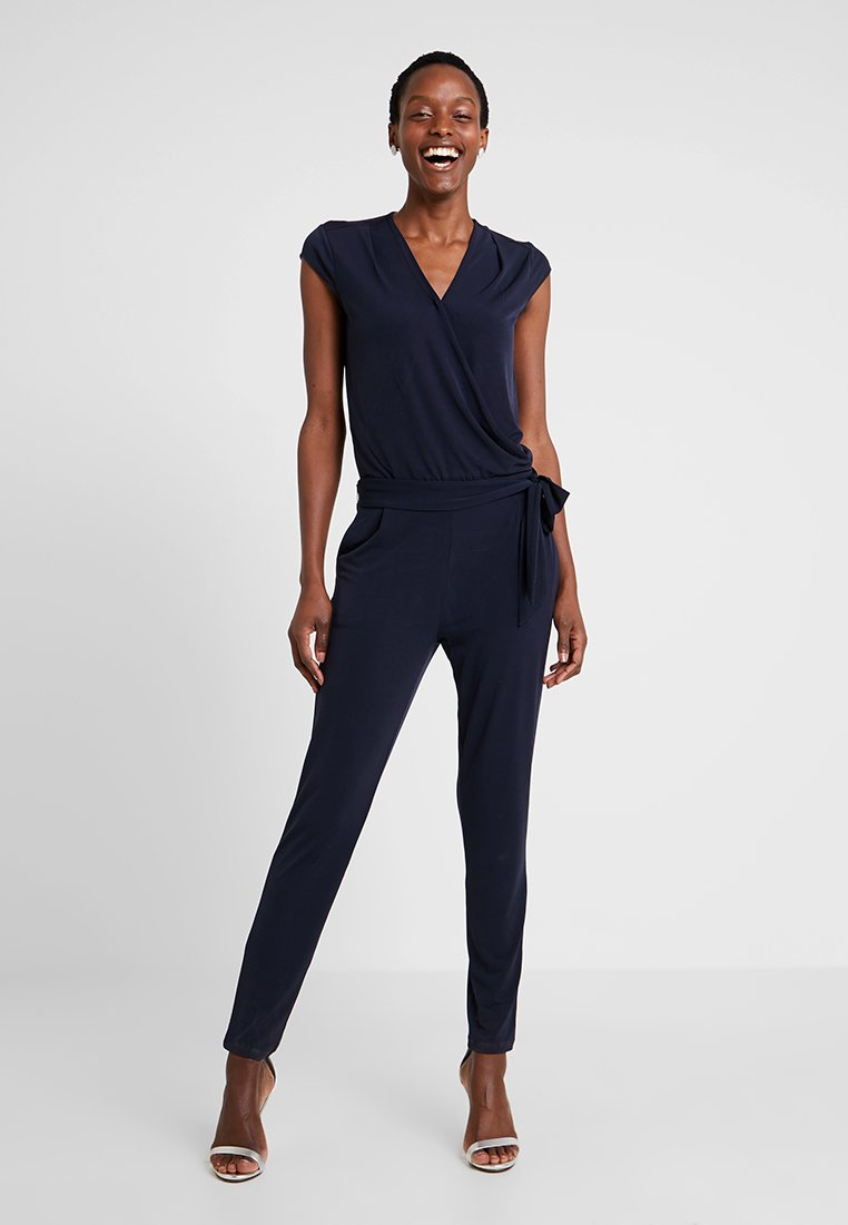 comma - OVERALL - Jumpsuit - tinte