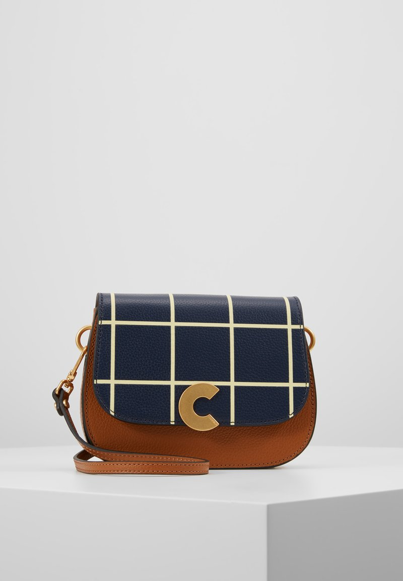 Coccinelle - CRAQUANTE TILES PRINT - Across body bag - ink/caramel