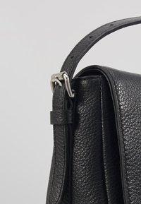 Coccinelle - ALIX GRAINY FLAP  - Across body bag - noir - 2
