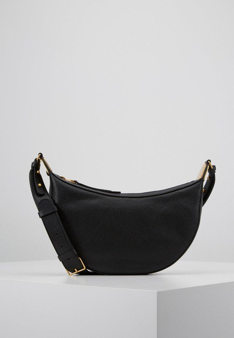 Coccinelle - ANAIS SOFT SHOULDER - Across body bag - noir