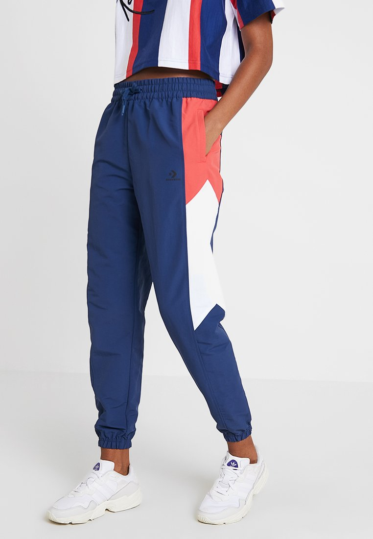 Converse - WARM UP PANT - Tracksuit bottoms - navy/multi