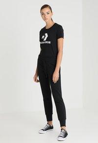 Converse - STAR CHEVRON SIGNATURE PANT - Spodnie treningowe - black - 1