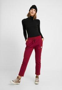 Converse - ALL STAR PANT - Pantaloni sportivi - back alley brick - 1