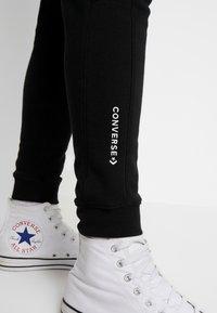Converse - SMALL WORDMARK JOGGER - Spodnie treningowe - black - 3