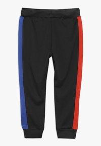 Converse - ASYMMETRICAL COLOURBLOCK PANT - Pantalon de survêtement - black - 1