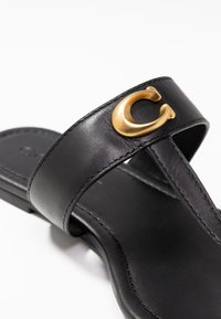 Coach - JESSIE THONG WITH SIGNATURE BUCKLE - T-bar sandals - black - 2