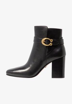 DELANEY - Kotníková obuv na vysokém podpatku - black