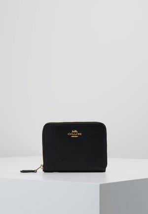 SMALL ZIP AROUND - Peněženka - black
