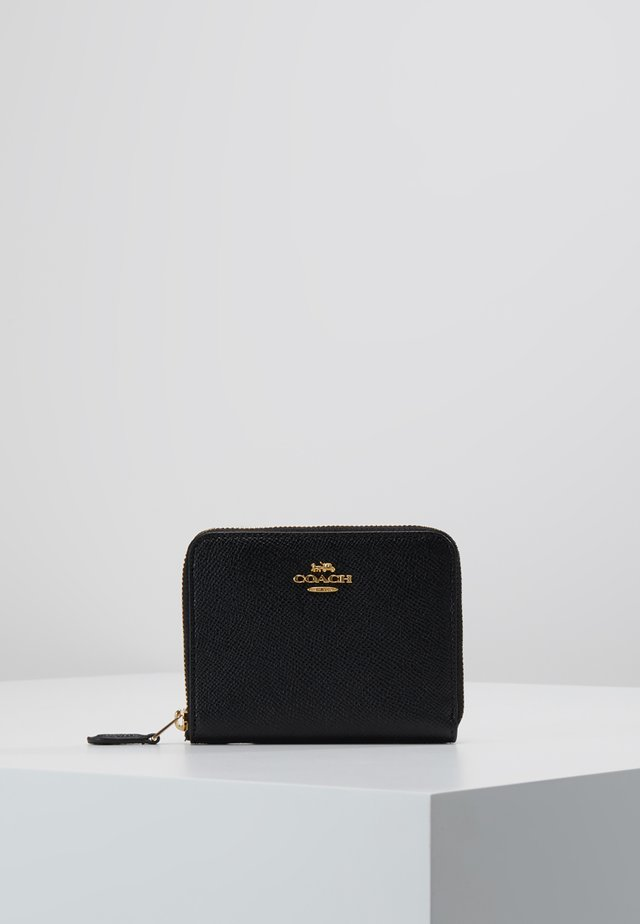SMALL ZIP AROUND - Wallet - black