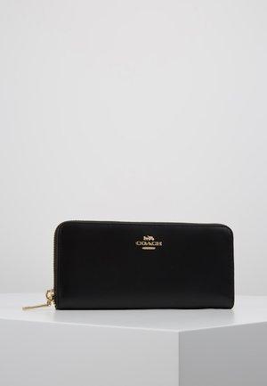 SLIM ACCORDION ZIP - Wallet - gold-coloured/black