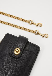 Coach - TURNLOCK CHAIN PHONE CROSSBODY - Mobiltasker - black - 4
